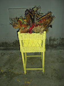 Yellow Wicker Planter with Flowers