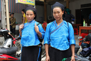 Two Nùng ethnic girls at the Sunday market