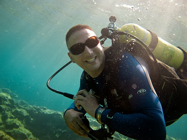 scuba diver wears sunglasses looking cool under the sea
