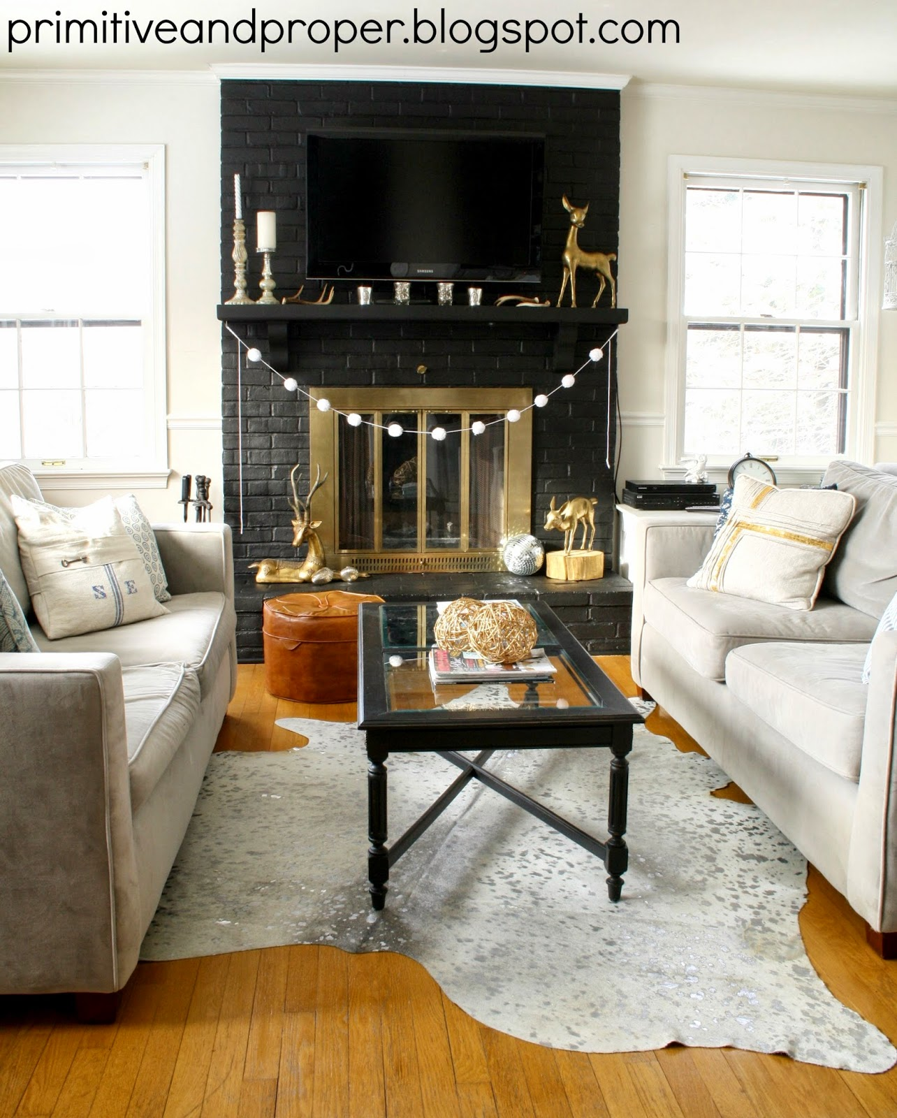 Dramatic Lamp Black Fireplace Makeover & Cowhide Rug From