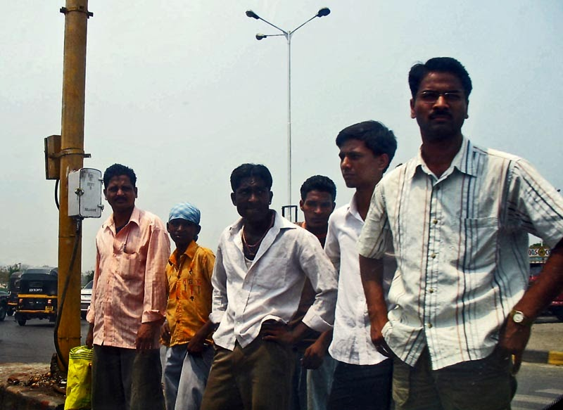 Group of men waiting to cross the road