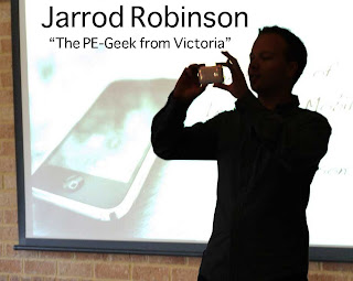 a man taking a picture of the title of Jarrod Robinson The PE Geek from Victoria