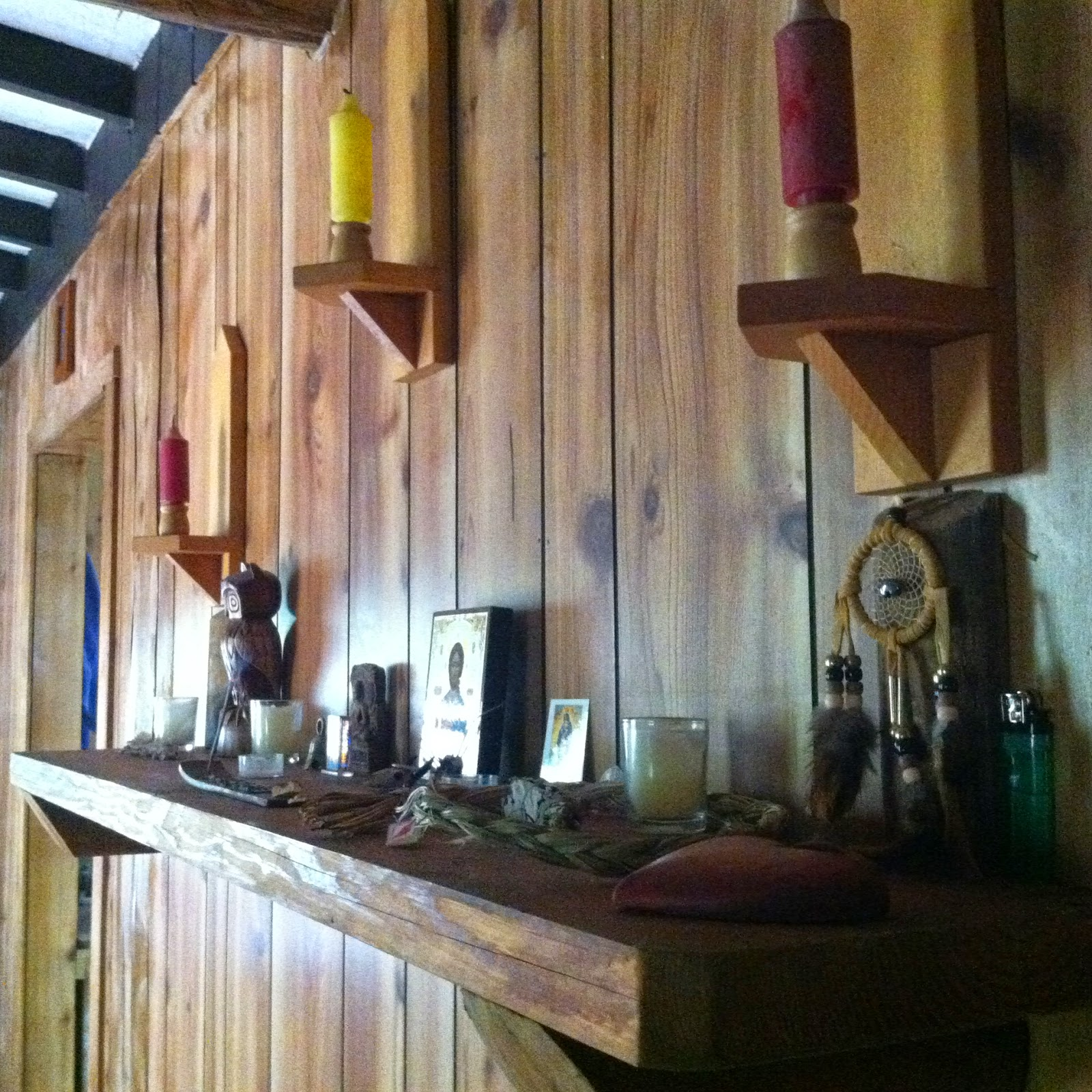 Altar in the main living space & whiskey bowling