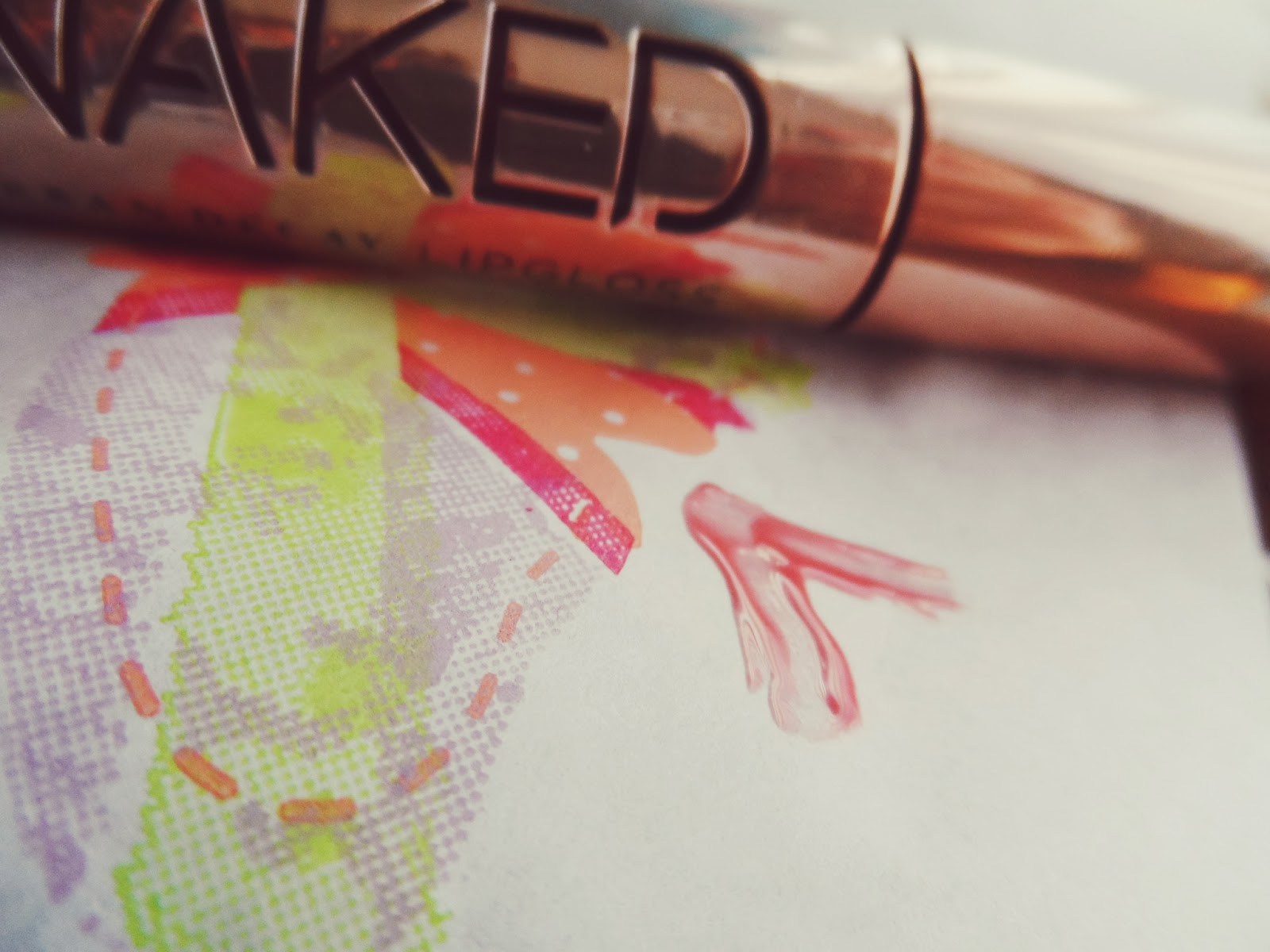 urban decay pink liar lipgloss swatch image