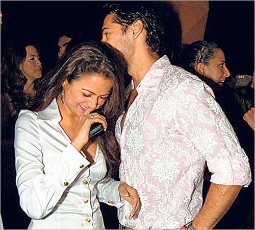 Dino Morea and Amrita Arora having fun in a party