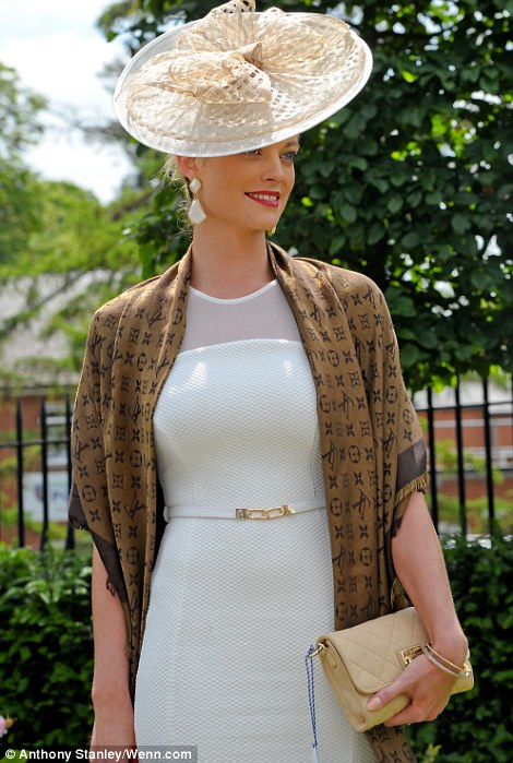 a  lady jazzed up her ensemble with a Louis Vuitton pashmina and a simple gold clutch on day 4 at Royal Ascot, 2014
