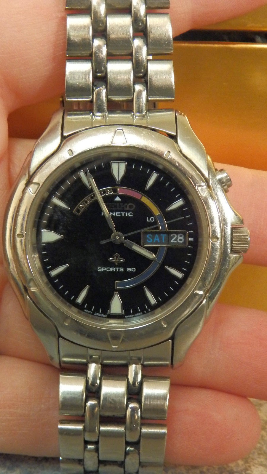 http://www.ebay.com/itm/mens-seiko-watch-kinetic-sports-50-Silver-tone-band-with-black-face-/321683536749?pt=LH_DefaultDomain_0&hash=item4ae5d53b6d