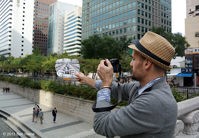 Earth Crack - Ben Heine adjusting a Pencil Vs Camera image in Seoul - 2013