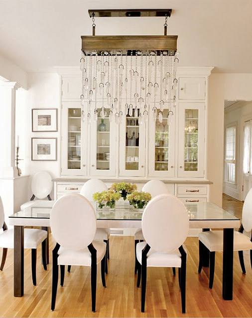 crystal drop chandelier in white dining room built in cabinets elegant style