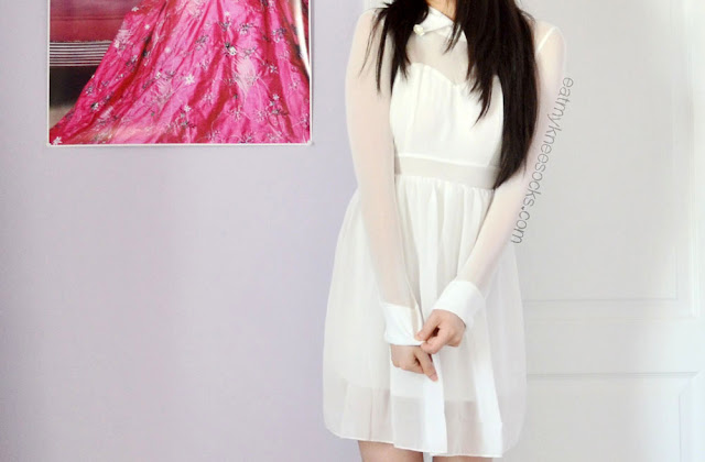 The quality and sizing on this white mesh WalkTrendy dress is different from the pictures, but it's still a cute, flirty white dress.