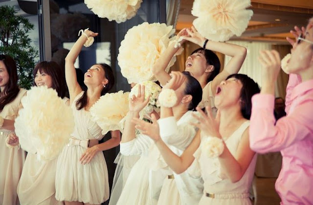 pompoms tossed in a wedding