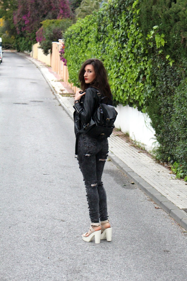 leather jacket, leather backpack, high waisted jeans, ripped jeans, platforms, high heels
