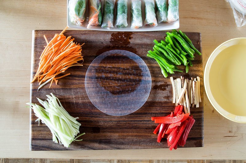 Vegan spring rolls rice paper wet on board