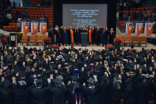 SHSU students sing the school song during the Commencement ceremony.