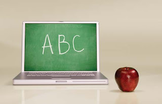 A computer with ABC on the screen