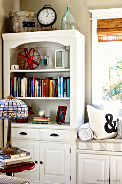 Built in bookshelf with window seat and stained glass lamp via www.goldenboysandme.com
