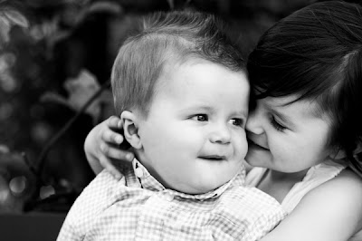Pictures of beautiful little baby boy and girl sharing Love