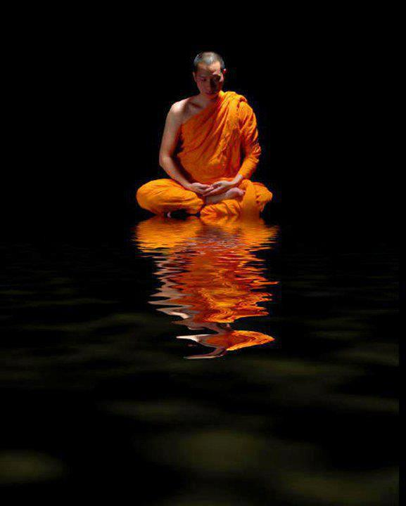 Buddhist Monk Meditation On Water
