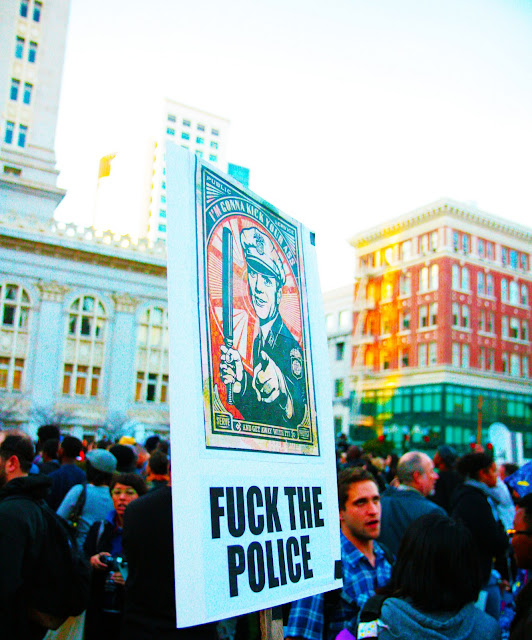 "An angry protest sign that says, ""Fuck The Police"", at a rally in downtown Oakland."
