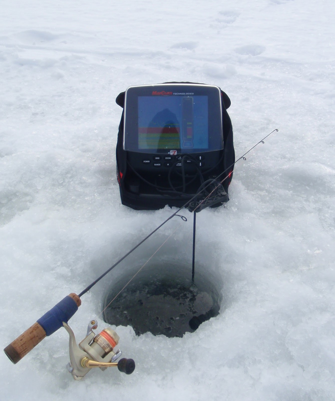 Bass junkies fishing addiction the rise of the marcum lx7 for Marcum ice fishing