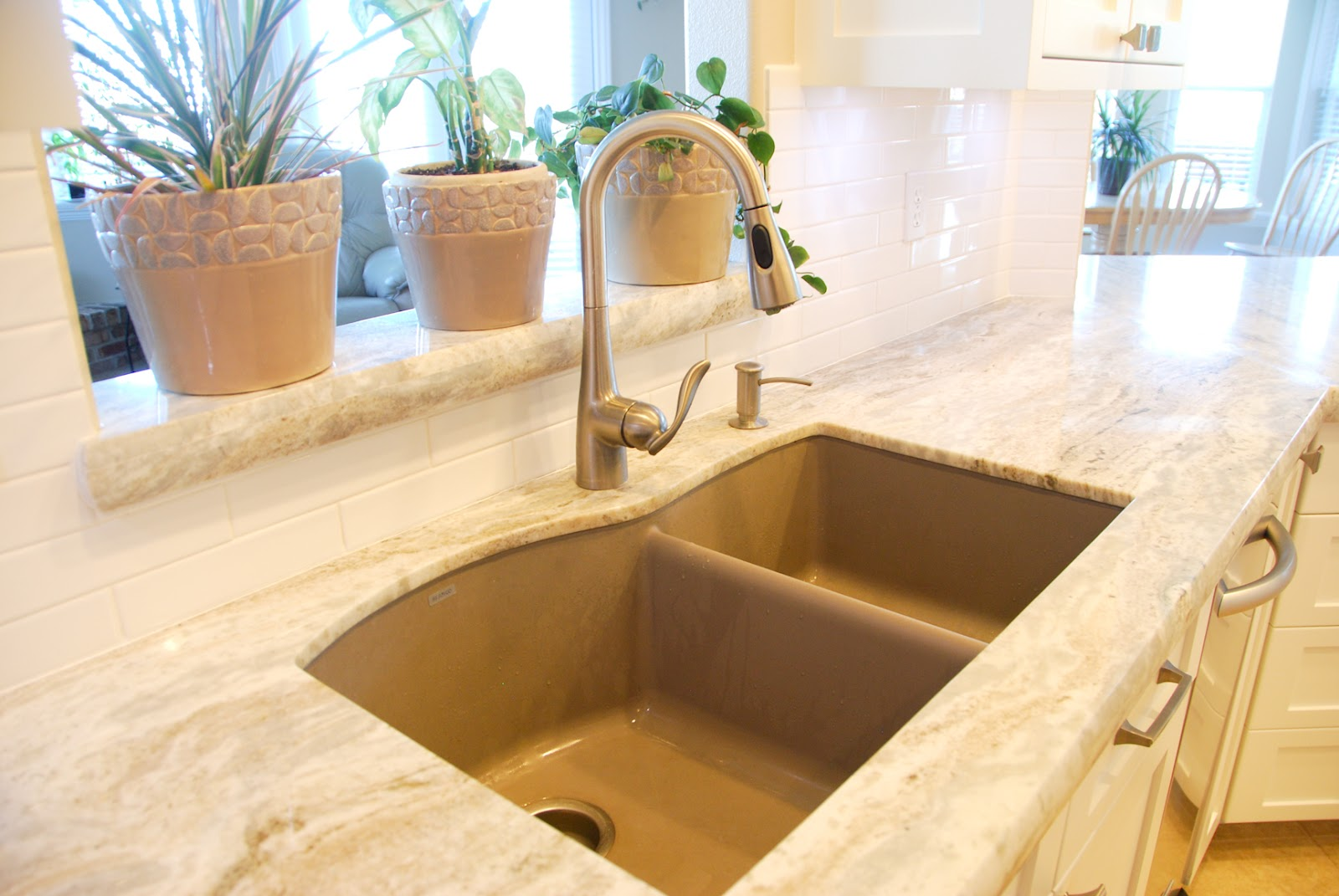 Countertops are fantasy brown granite the backsplash is marble - Photo Mgs By Design