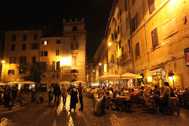 A restaurant is located nearby the Fontana del Pantheon and the Pantheon in Rome, Italy