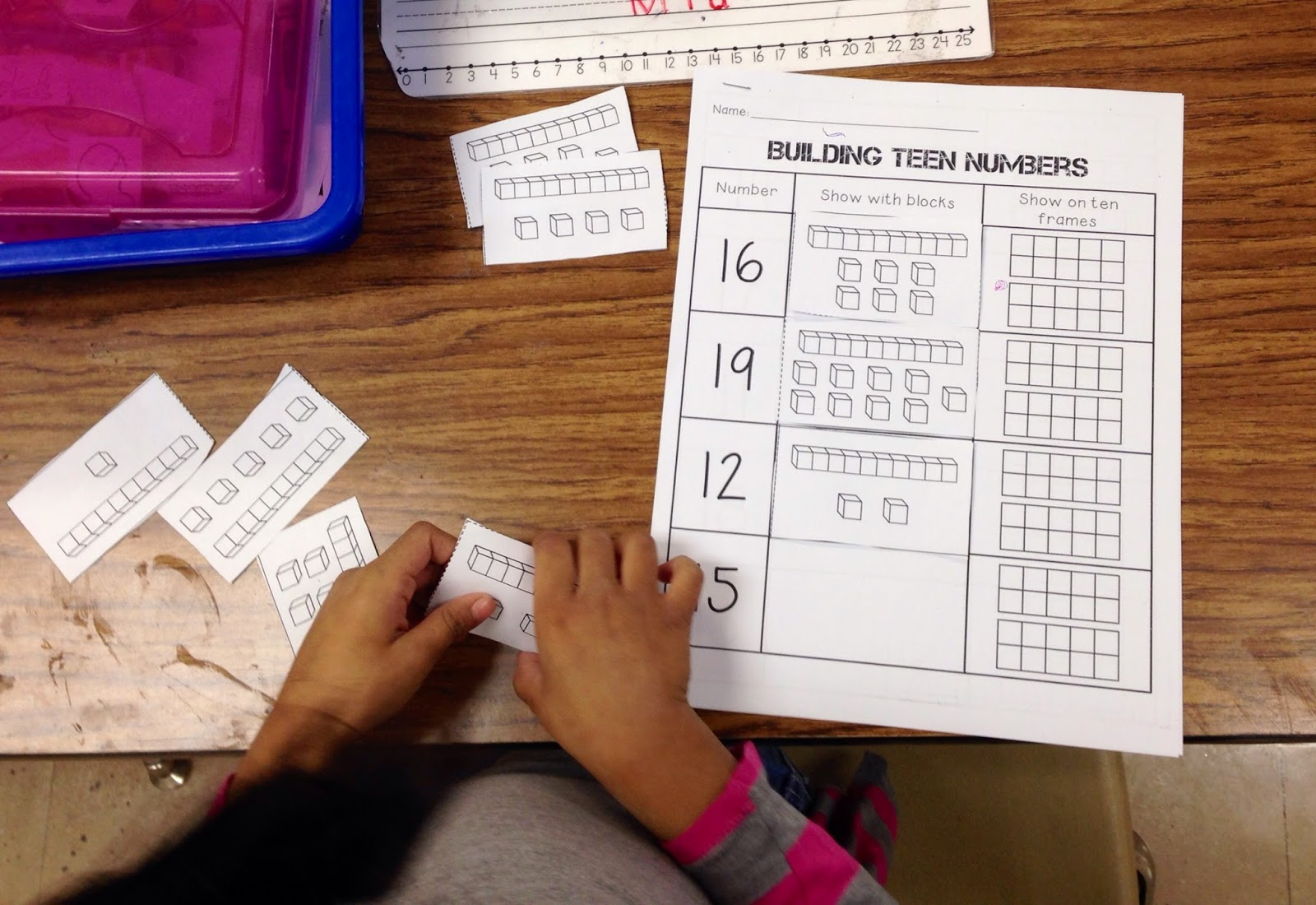 we took all of our knowledge with ten frames and base ten blocks and to show teens numbers