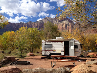 White travel trailer in campsite, Zion National Park, Navajo sandstone buttes and mesas in the background