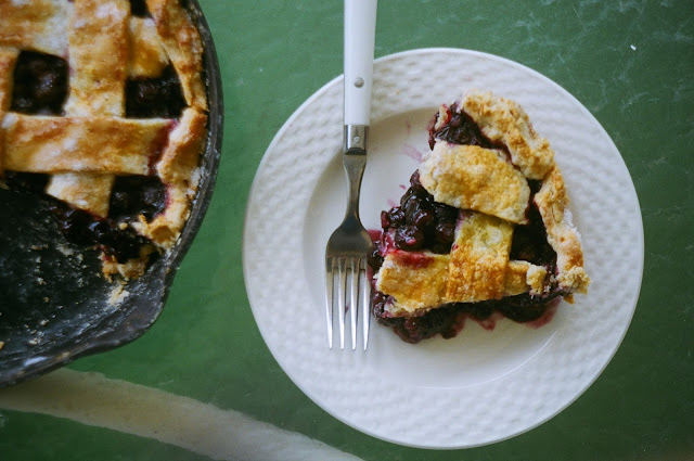 Blueberry Pie in Cast Iron Skillet with Slice