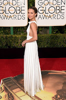 The Danish Girl star Alicia Vikander in white apron dress at the 2016 Golden Globe Awards Red Carpet photo