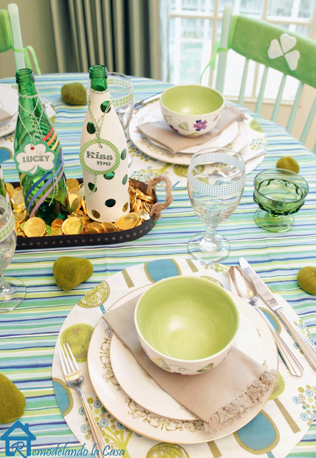 Green bottle centerpiece, plates and chair covers adorn a St. Paddy's table
