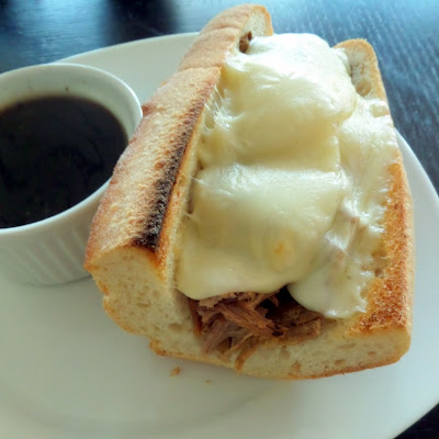 Slow Cooker Roast Beef Sandwiches:  Beef roast slow cooked in broth and beer until tender then placed on a baguette and topped with melted cheese.  The cooking liquid can be used as a dipping sauce.