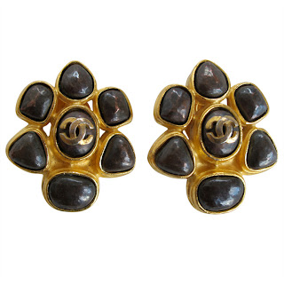 "Vintage 1990's brown and gold stone flower Chanel earrings with ""CC"" logo in the center."