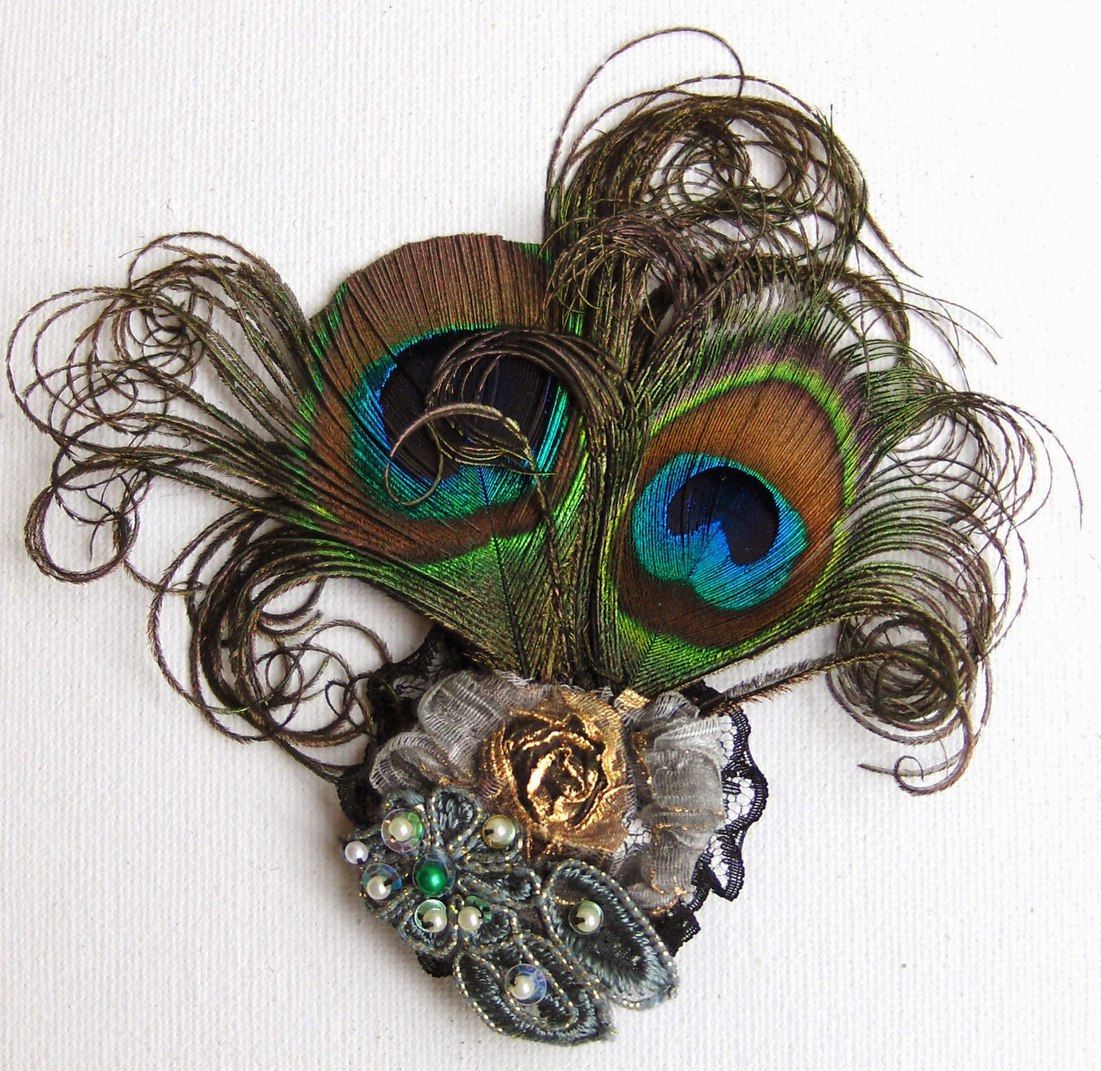 http://folksy.com/items/653352-Sweet-little-Peacock-hair-clip-barrette