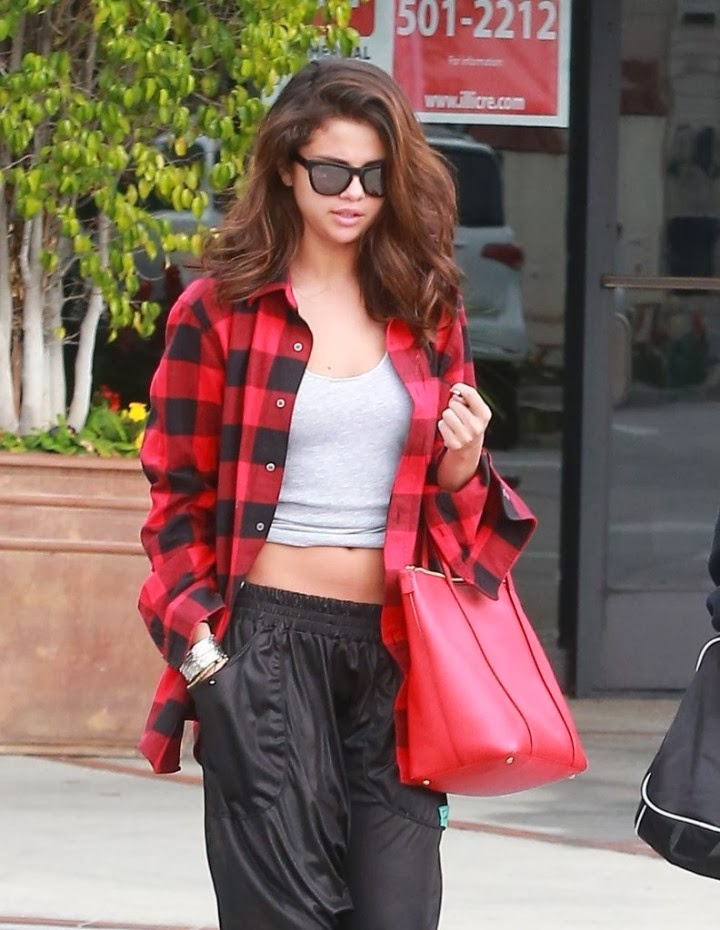 Selena Gomez steps out in slouchy leather-look trousers and a red flannel shirt in Sherman Oaks