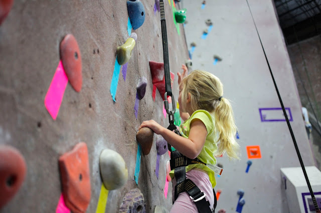Child climbing at The Edge Rock Gym
