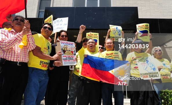 Filipinos protest in front of the Chinese Consulate in Los Angeles on May 11, 2012 in California, as part of a global protest over an escalating territorial row in the South China Sea. The territorial row centres on Scarborough Shoal, a tiny rocky outcrop in the South China Sea about 230 kilometres (140 miles) from the Philippines' main island of Luzon which the Philippines says is part of its territory because it falls within its exclusive economic zone. China, however, claims virtually all of the South China Sea, which is believed to sit atop huge oil and gas reserves, as its historical territory, even waters close to the coasts of other Asian countries. Editorials in newspapers controlled by the ruling Communist Party have repeatedly warned that China is prepared to go to war against the Philippines to end the stand-off. AFP PHOTO/Frederic J. BROWN (Photo credit should read FREDERIC J. BROWN/AFP/GettyImages)