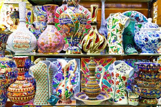 show window full of colorful crafts