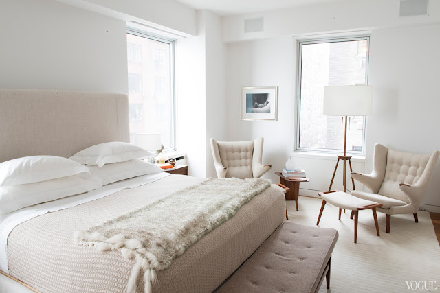 white color palette bedroom upholstered bed wegner papa bear chairs neutral cream new york city nyc apartment decor