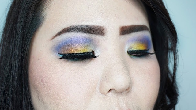 A tutorial for Colorful summer inspired makeup look. Purple, blue and yellow eye look for summer photoshoot. MUA: Theresia feegy