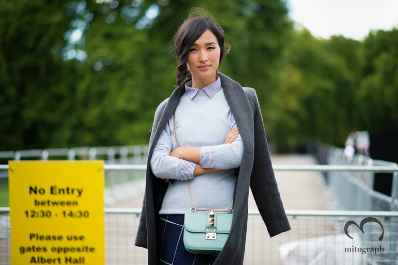 Nicole Warne wears Zara Coat United Colors of Benetton Shirt Theory Sweater Whistles Skirt Valentino Bag at Burberry Prorsum London Fashion Week LFW