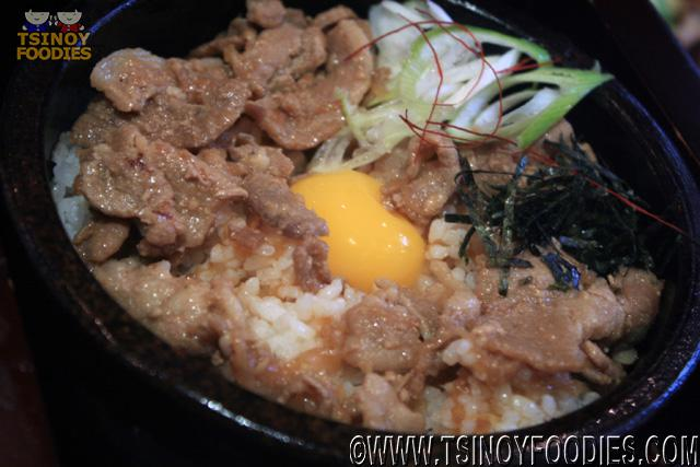 pork rice with egg yolk in stone pot