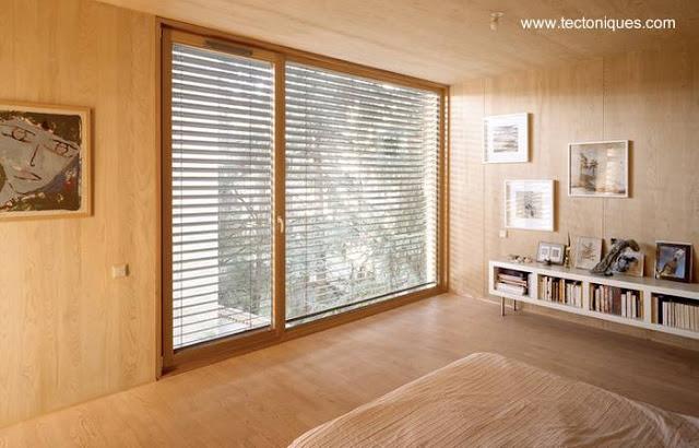 Dormitorio de casa de madera en Francia