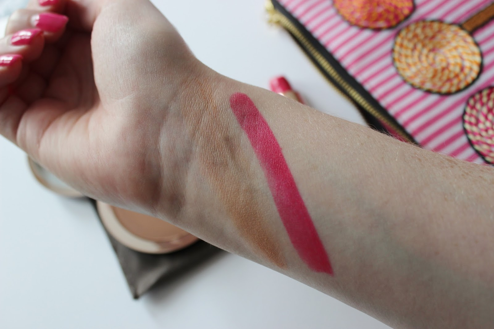 Delilah cosmetics sunset bronzer and Stiletto lipstick swatches