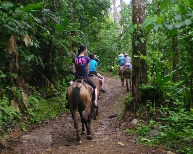 our family horseback riding to Nauyaca Falls, Costa Rica