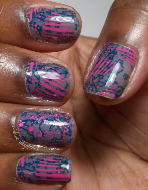 Blue jelly polish base stamped with navy blue floral outline pattern, and then with a pink abstract heart pattern. Accent ring finger is covered with pink matte glitter instead of the second stamping of pink over the blue base.