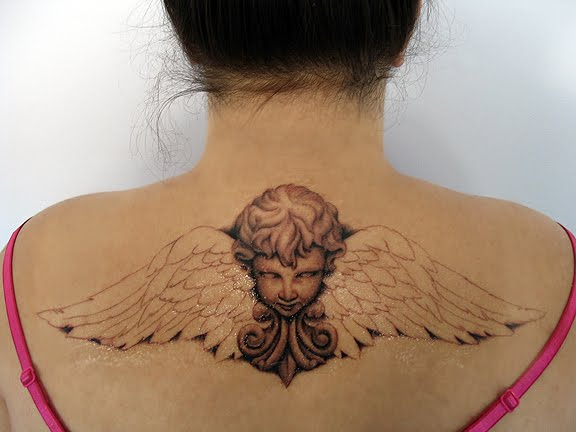 Photo Of Superb Tattoo With Wings On Back