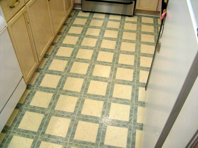 Diy herringbone tile floor using peel stick vinyl for Stick down linoleum tiles