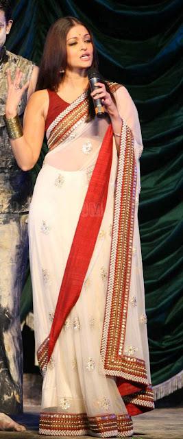 1212 aishwarya rai at Raavan-Music-Launch-at-Yash-Raj-Studios- in white lace saree3