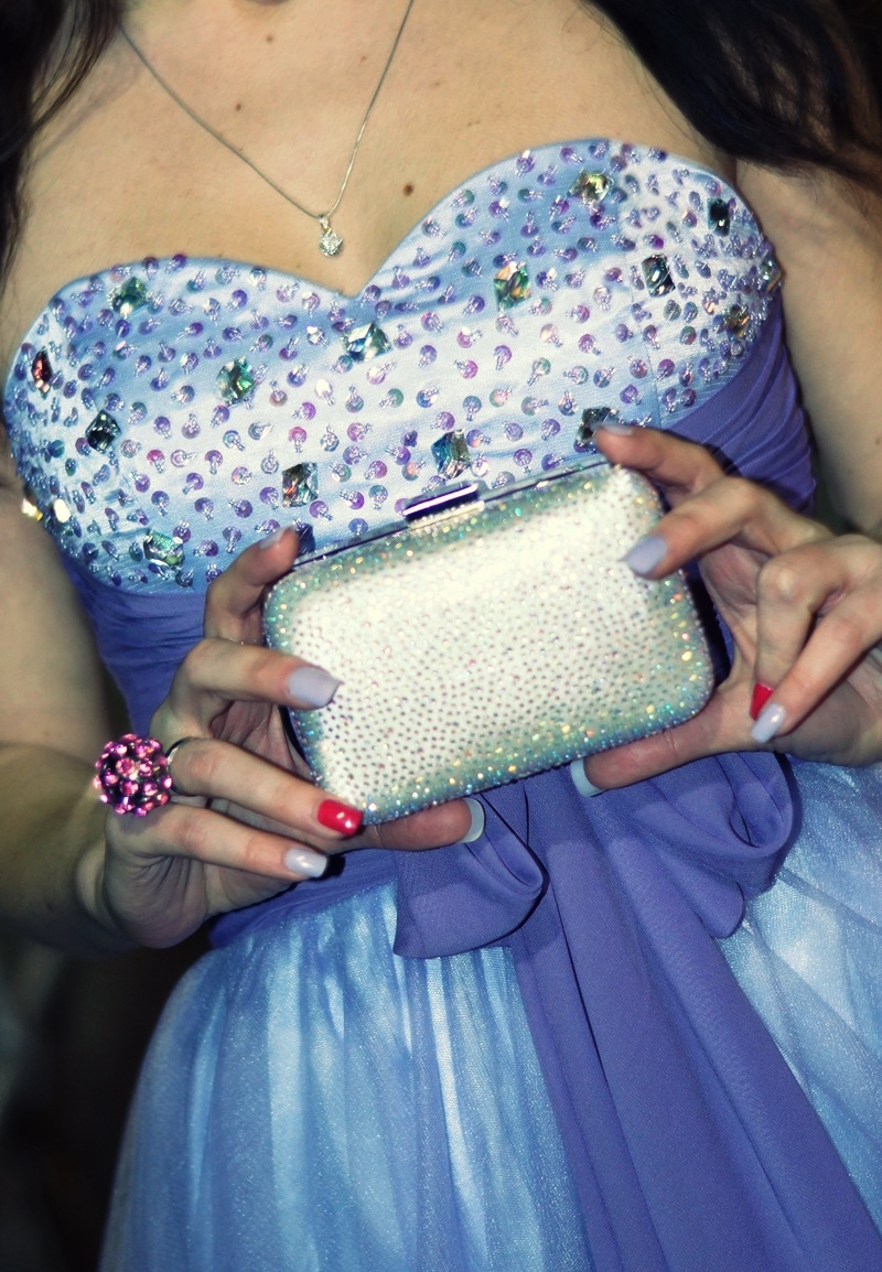 Silver sparkling clutch bag and dress